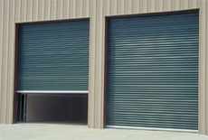 image of Janus Commercial Sheet Door model # 2000 on aarons garage door service in san antonio, austin, new braunfels, san marcos, and marble falls